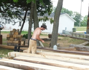 Log home specialist hand-shapes logs