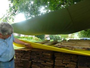 David Collier shows off the new shakes (shingles) for the roof.